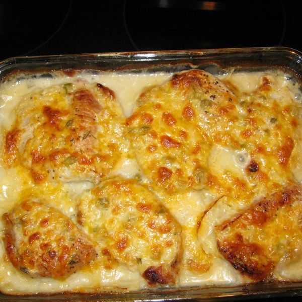 "Pork Chop and Potato Casserole | ""My family loves this recipe. It is easy and delicious. Pork chops are browned, then baked in a creamy mushroom sauce with potatoes, onion and cheese."""