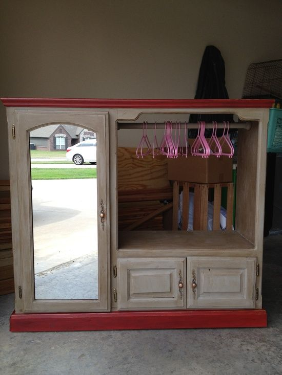 Old entertainment center repurposed into a little girls dress-up armoire. Fun and I bet I could get one like this for super cheap at goodwill