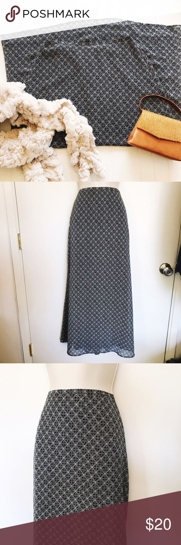 "Black And White Maxi Skirt Black And White Maxi Skirt  Feels like 100% Polyester   Waist 30"" Length 37"" Skirts Maxi"