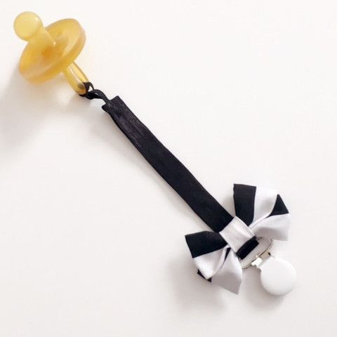 These trendy, stylish pacifier clips are the perfect accessory for keeping your little bunny's binky clean and within hands reach. Made from soft black elastic and accented with a fabric bow, each cli
