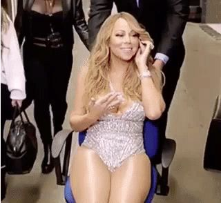 And the most incredible is definitely this moment where she's being escorted via chair while chillin'. | Caption This Insane GIF Of Mariah Carey Being Pushed In A Chair
