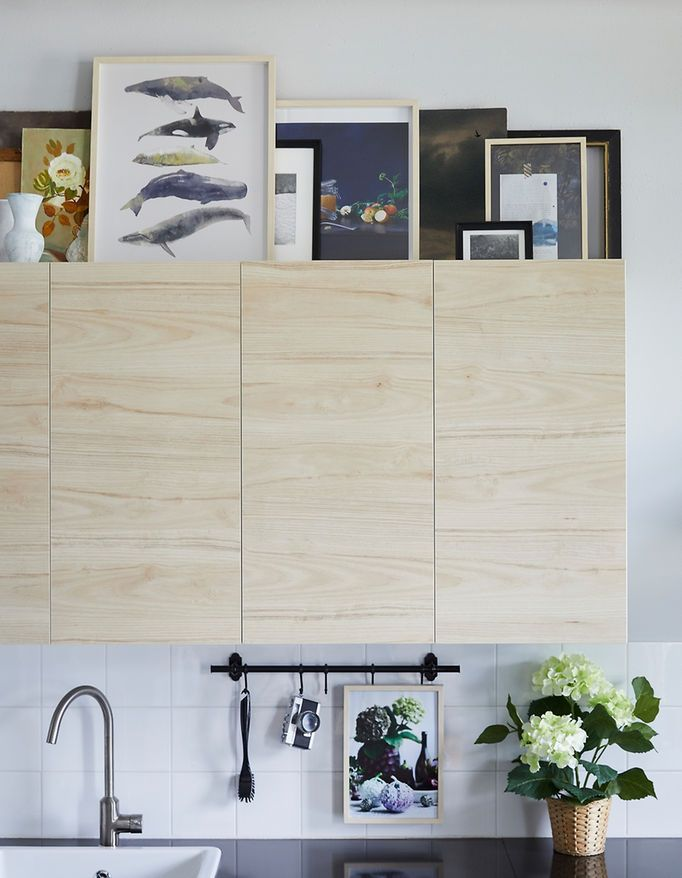 Want art for your kitchen? IKEA has lots to choose from, especially pieces easy to see at a distance for those spots above kitchen cabinets. For a calm look, choose one or two frame styles like modern HOVSTA frame in birch.