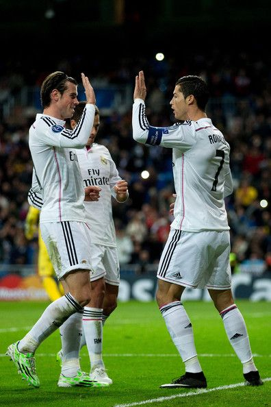Cristiano Ronaldo and Gareth Bale Photos Photos - Cristiano Ronaldo (R) of Real Madrid CF celebrates scoring their opening goal with teammates Gareth Bale (L) and Javier Hernandez Chicharito (2ndL) during the UEFA Champions League Group B match between Real Madrid CF and PFC Ludogorets Razgrad at Estadio Santiago Bernabeu on December 9, 2014 in Madrid, Spain. - Real Madrid CF v PFC Ludogorets Razgrad
