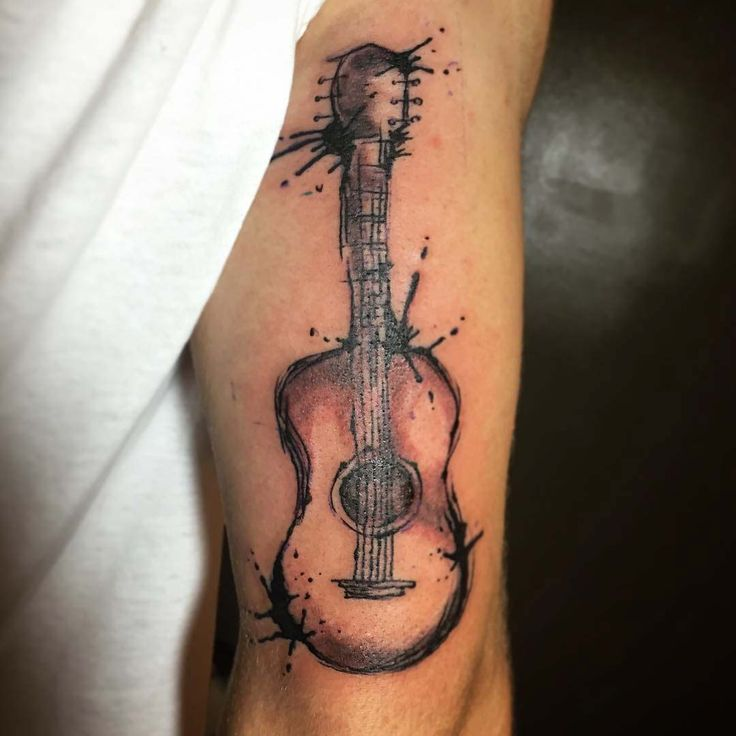 Acoustic-Guitar-Tattoo-on-Tricep-by-grovetattoo.jpg (1080×1080)
