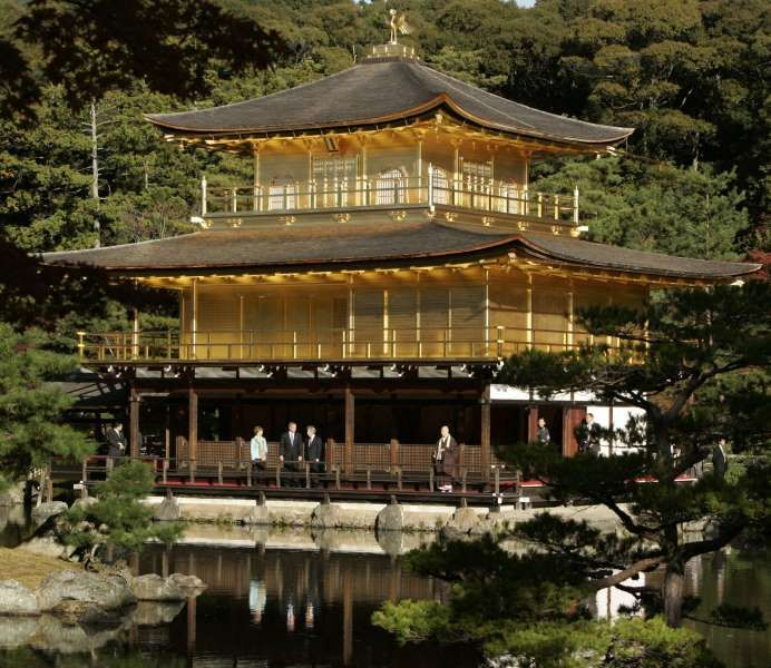 """Temple of the Golden Pavilion ﴾Kyoto, Japan﴿ The top two stories of this Zen Buddhist temple are completely coated with pure gold. It is part of the wider World Heritage Site """"Historic Monuments of Ancient Kyoto"""", and remains a hugely popular tourist destination."""