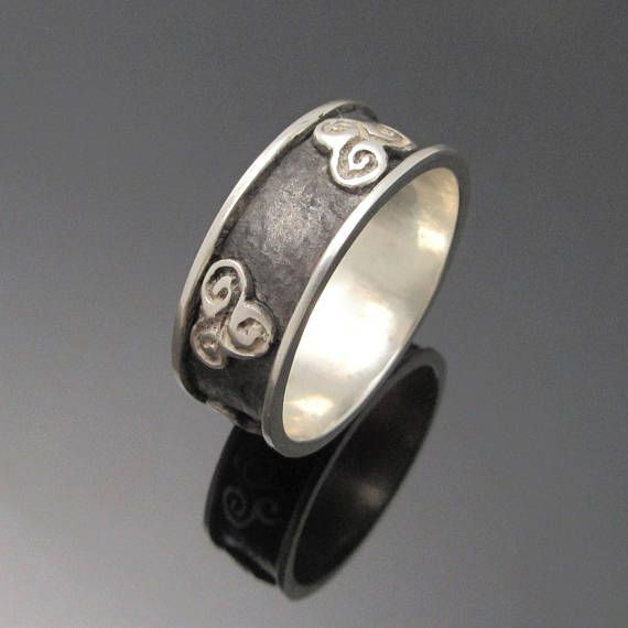 Check out this item in my Etsy shop https://www.etsy.com/ie/listing/504192529/newgrange-triple-spiral-ring-triskele