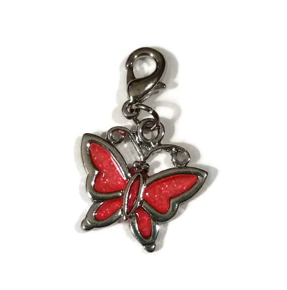 Check out this item in my Etsy shop https://www.etsy.com/ca/listing/523373967/coral-pink-butterfly-charm-clasp-enamel
