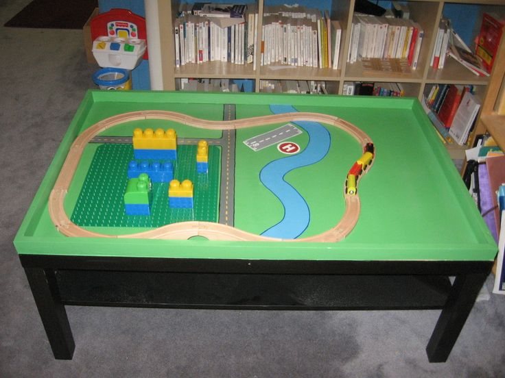 """IKEA Lego and train table: use an inexpensive """"Lack"""" coffee table with built-in shelf for storage."""