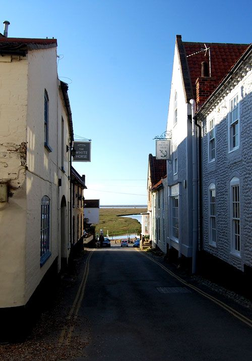 Blakeney North Norfolk . View down the high street to the quay