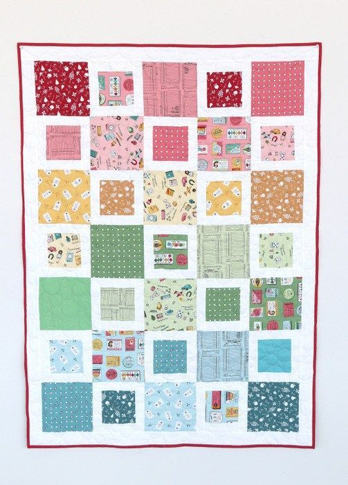 Fast, beginner-friendly crib-size quilt tutorial. Perfect for showing off cute fabric, such as these prints from Heidi Staples Five & Dime collection.