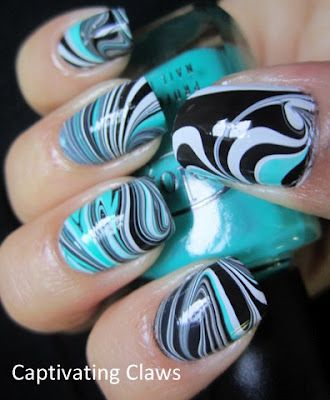Black, White, and Teal Water Marble Nails