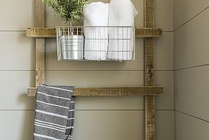 rustic ladder for Bathroom toiletries and towels- perfect if u dont want to ruin walls with nials and hooks.
