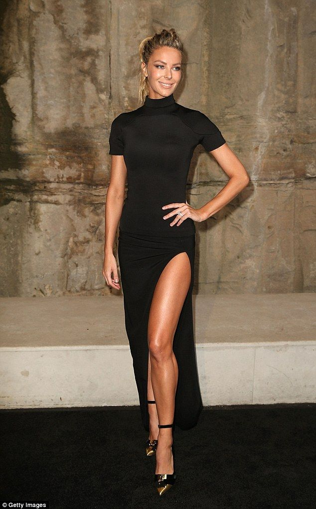 Thigh's the limit! Jennifer Hawkins dazzled in a  black dress with revealing thigh-split a...