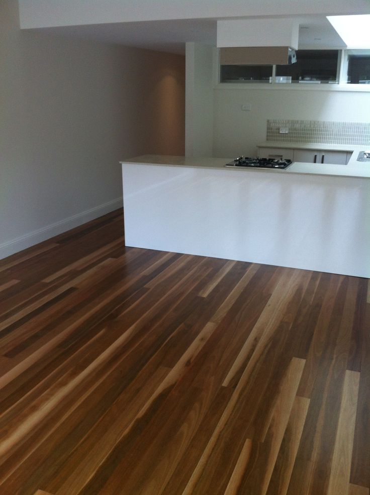 Spotted Gum timber flooring installed over a concrete slab