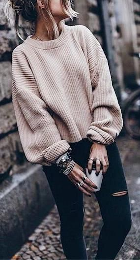 oversized nude jumper + skinny ripped black jeans. street style.