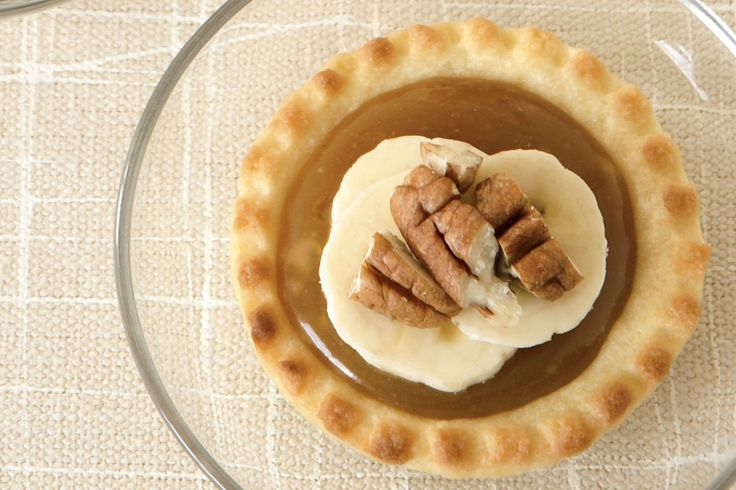 Pecans boost the flavour and add crunch to these individual caramel and banana pies.