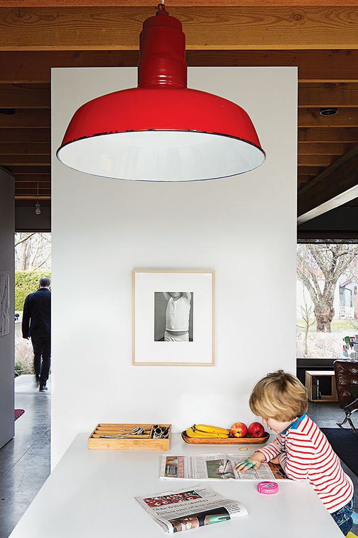 A bungalow literally raised the roof in vancouver the pendant lamp is a vintage find photo by architecture by darcy jones architecture by dwellmagazine
