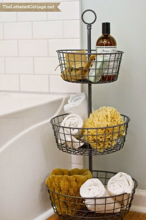 Guest bath idea, also could be used to keep kid's toys in order. Such pretty bathroom storage!