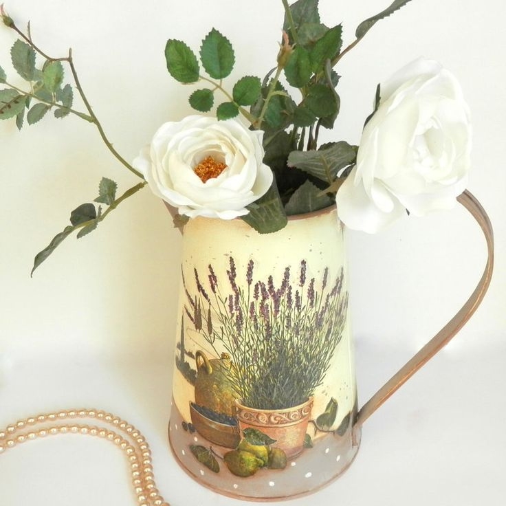 Decoupage on metal watering can