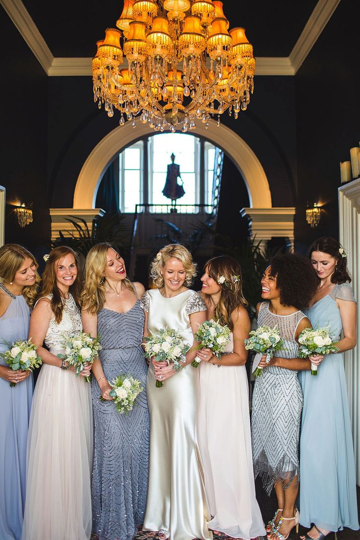 Bridesmaids wear pink and blue mismatched dresses | Photography by http://s6photography.co.uk/