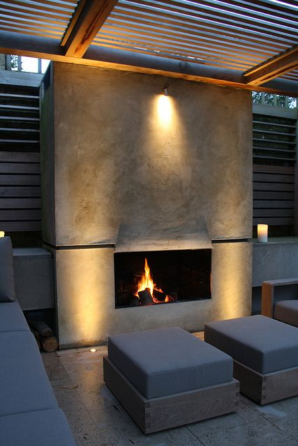 Formal Structural Garden | Contemporary timber arbour encloses outdoor garden room, with log burning fire | Charlotte Rowe Garden Design