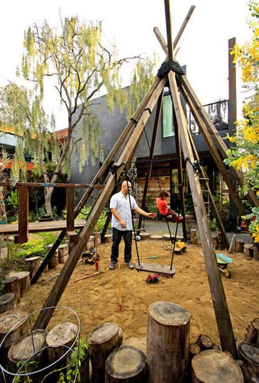 teepee swing set and climbing ropes - would be great for trellis plants, too - I'm thinking hops or something; could be a shady playhouse in late summer!
