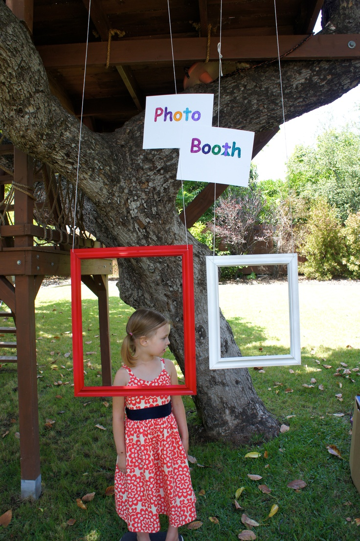 Photo booth at carnival birthday party.  this would be a cool idea with some  added accent lighting.