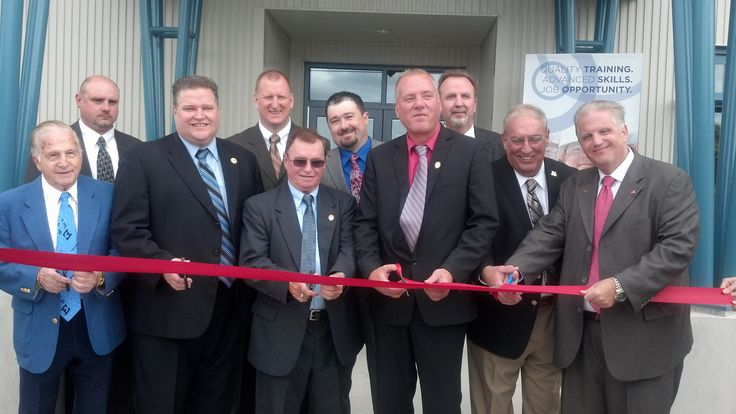 Scott Martel, Local Union 773's business manager (center) cutting the ribbon, announcing the grand opening of his new facility.