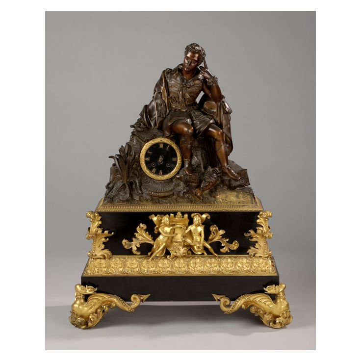 """""""Lord Byron"""", first half of 19th Century.  Gilt bronze mantel clock depicting Lord Byron sitted on ruins. He is dressed in a English costume carrying his pistol and sword.  Dimensions: 83Χ66Χ28 cm."""