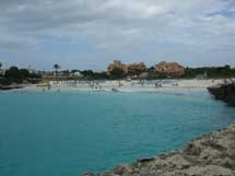 Cala'n Bosch beach in Menorca is a white sandy gently shelving beach with clear blue water suitable for families?