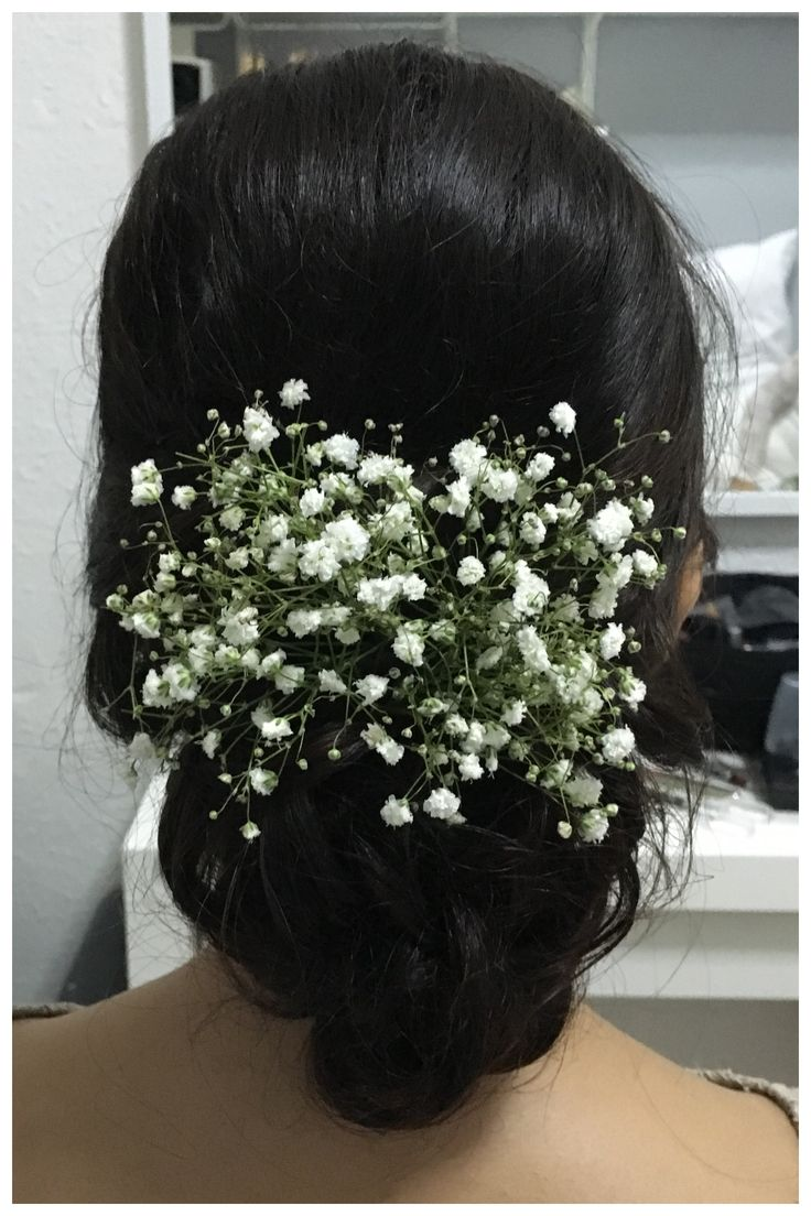 Simple updo hairstyle with baby breath. #bridalhair #babybreath #wedding #hairstyle #updo