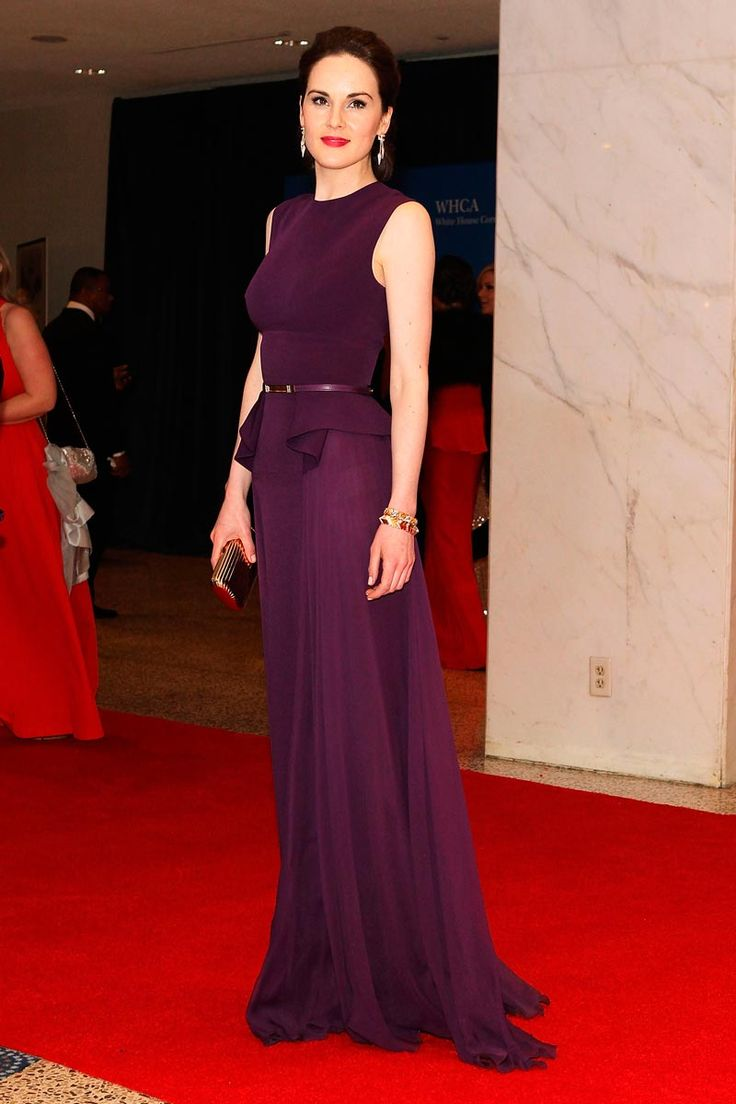 Michelle Dockery at the White House Correspondents Dinner wearing a plum Elie Saab dress with peplum detail and gold metal bel
