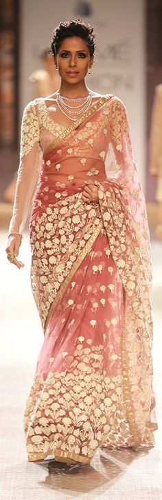 A beautiful peach colored net saree displayed at one of the LFW events.