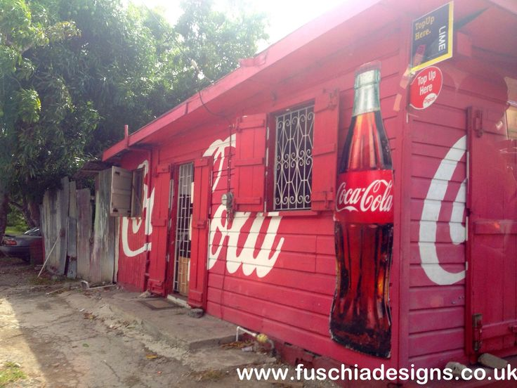 Coca Cola branding to show the coke is sold at this shop in Barbados.  By www.fuschiadesigns.co.uk.
