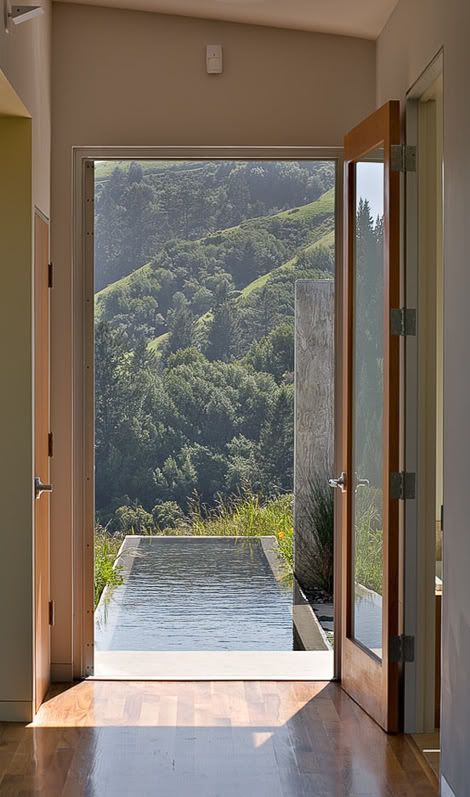 Can you imagine walking out the side/back of your house to jump in the pool for some laps? What a view too!!