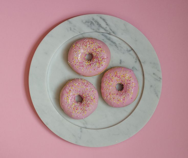 Pink donuts on carrara marble plate from Stenhuggardottern