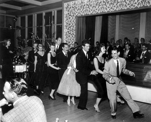 "This just makes me smile: the bunny hop!     Source: westernclippings.com says:  ""Ray Anthony leads a group as they dance to his big hit of ""The Bunny Hop"" at Ciro's. Behind Anthony is actress Mitzi Gaynor and Hugh O'Brian. Man with the mustache is comedian Jerry Colonna. Marie Windsor watches on the left""."