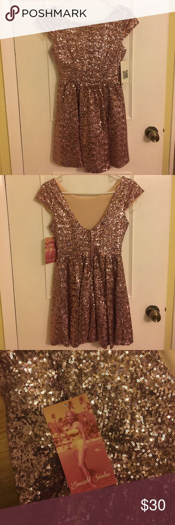 Never worn, with tags. Pink sparkly dress. Dress is a size 3. Emerald Sundae Dresses Prom