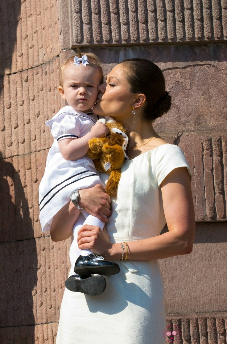 MYROYALS  FASHİON: Swedish National Day 2013:  Crown Princess Victoria gives a kiss to daughter Princess Estelle during celebration of the Swedish national day.