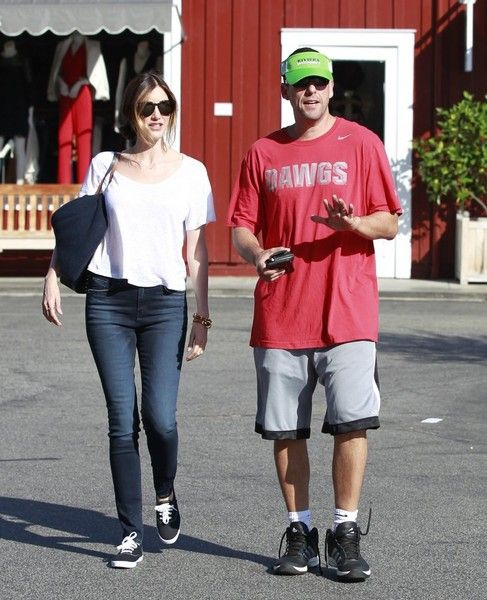 Couple Adam and Jackie Sandler enjoy breakfast together at the Brentwood Country Mart.