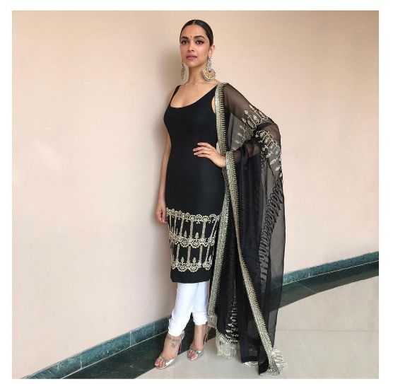 Miss Padukone wears a textured silk bodycon kurta with beadwork details and an embellished organza dupatta. The look is paired down with a crisp poplin churidaar