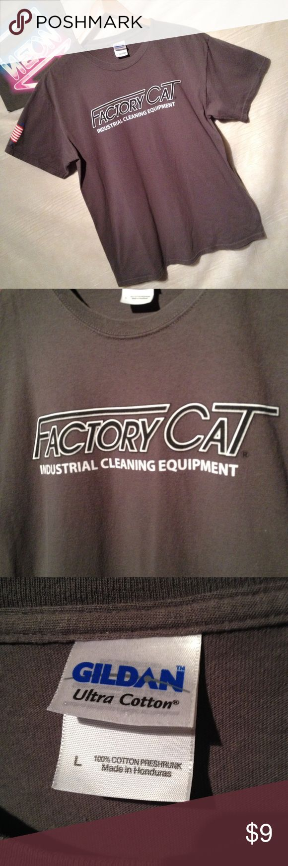 "Industrial supply factory cat gray shirt size L Used t-shirt with some color fading, no holes or tears with American flag on sleeve.  Ships from smoke free environment, 1 day handling.  Chest - 21"" shoulder to hem 27"" Gildan Shirts Tees - Short Sleeve"