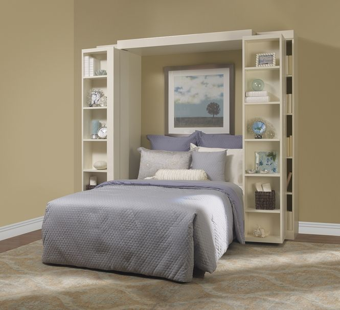Incredible for home office guest bed. Bed folds up and hides away and front left and front right bookcases slide in front. Click to view site, really awesome