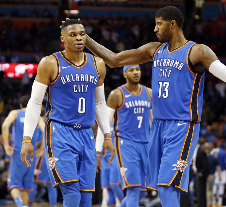 Oklahoma City's Paul George (13) touches Russell Westbrook (0) on the head as Westbrook leaves the court for the last time in the fourth quarter of an NBA basketball game between the Oklahoma City Thunder and the Golden State Warriors at Chesapeake Energy Arena, Wednesday, Nov. 22, 2017. The Thunder won 108-91. Photo by Nate Billings, The Oklahoman