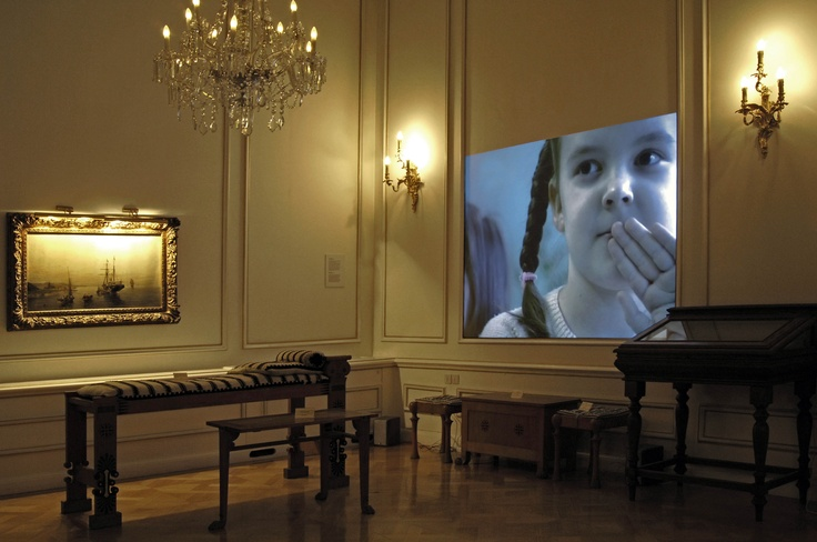 """Her(his)tory"" Video art exhibition. Victor Alimpiev Summer Lightnings, 2004. Video projection, 2΄30΄.  Courtesy the artist and Regina Gallery, Moscow. Photo credit: Rebecca Constantopoulou & Fanis Vlastaras."