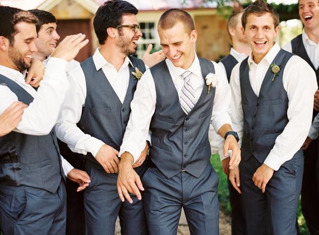 for the boys Charcoal groomsmen gray vests charcoal suit striped tie laughing