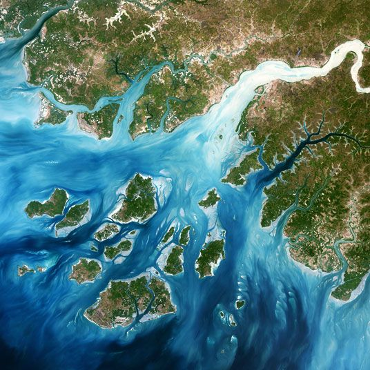 One in every 15 people on the planet - around 500 million people - call river deltas home.  A delta in Bijagos archipelago, West Africa Picture: SPL / Barcroft Media