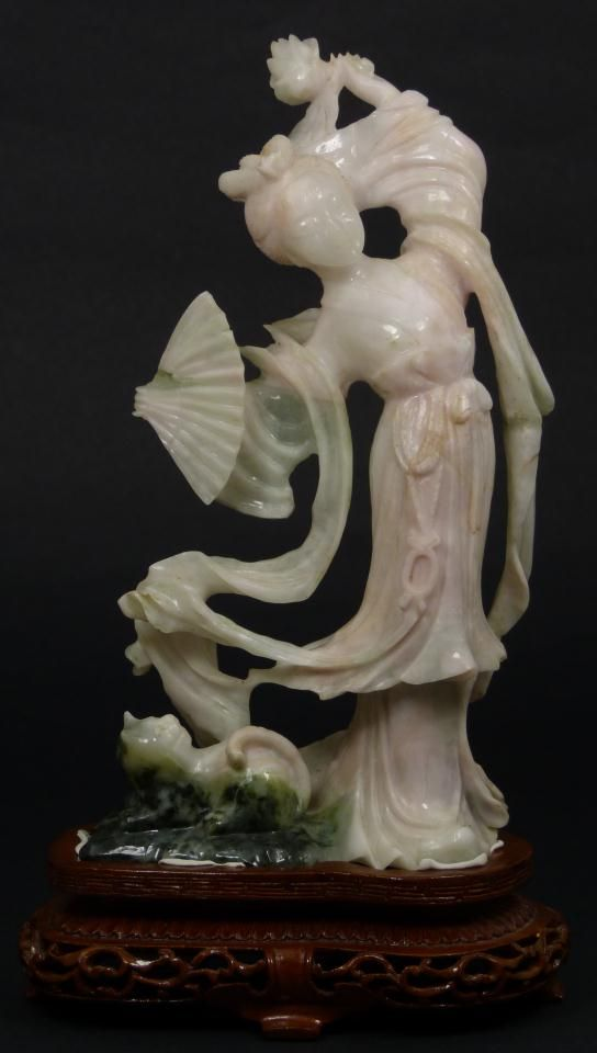 CHINESE HAND CARVED WHITE JADE QUAN YIN FIGURE  Antique Chinese hand carved jade Guan Yin figure. She is depicted in layered robe and folding fan to right hand with a cat at her feet. Glowing white jade having translucence with hints spinach green. 19th/20th century.