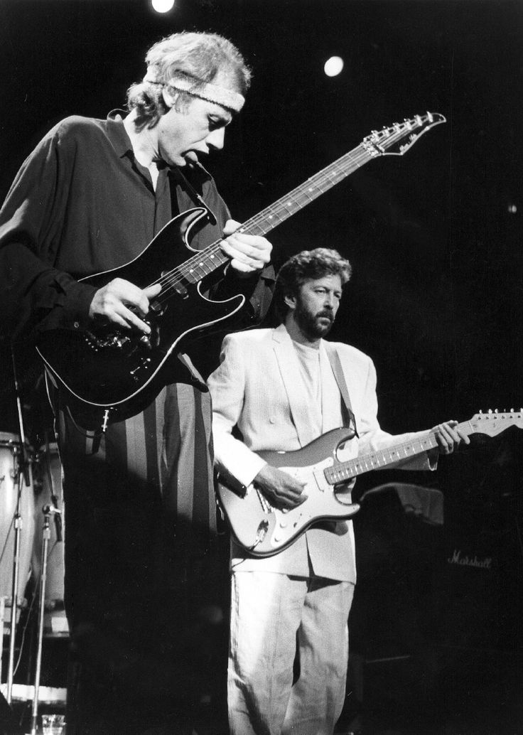 Mark Knopfler with Eric Clapton in the background