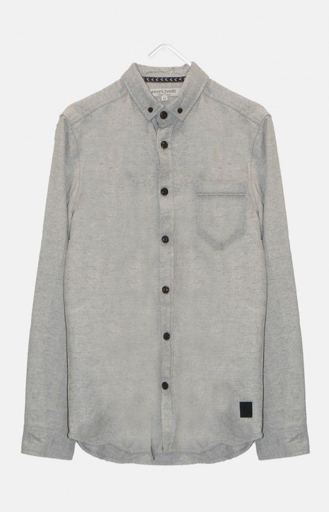 FREDA from ANERKJENDT is a marbled long sleeve shirt with a curved hem that extends around the rear and a chest pocket.